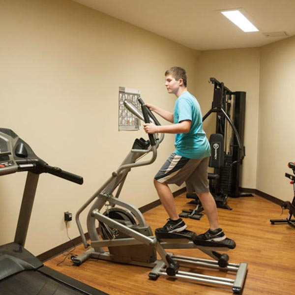 Individual Using an Elliptical in Gym